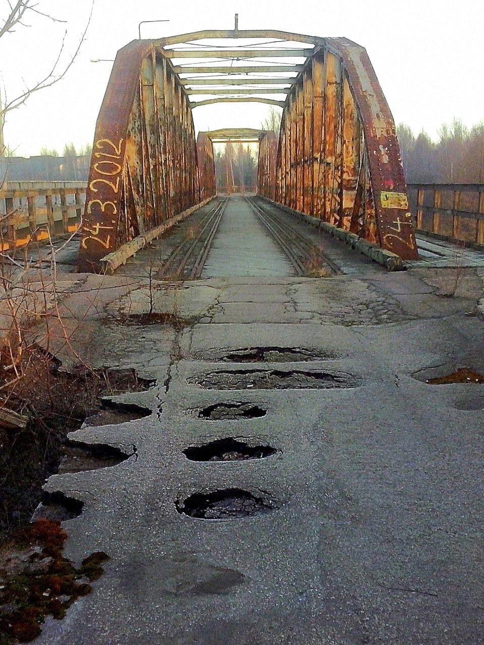 Old Abandoned Railway Bridge Against Sky
