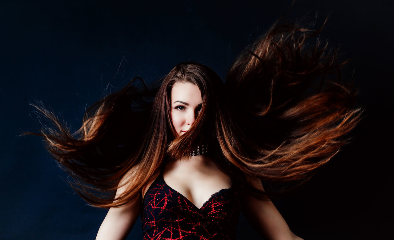 Action Activity Beautiful People Beauty Brown Hair Elégance Fashion Females Flying Glamour Hairstyle Human Hair In Action Long Hair Motion Portrait Studio Shot Surreal