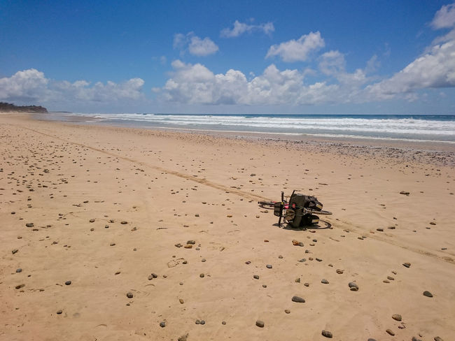 Kickbike on side in sand on beach Beach Coastline Horizon Over Water Kickbike Sand Sea Seascape Shore Summer Surf Water Wheel Tracks