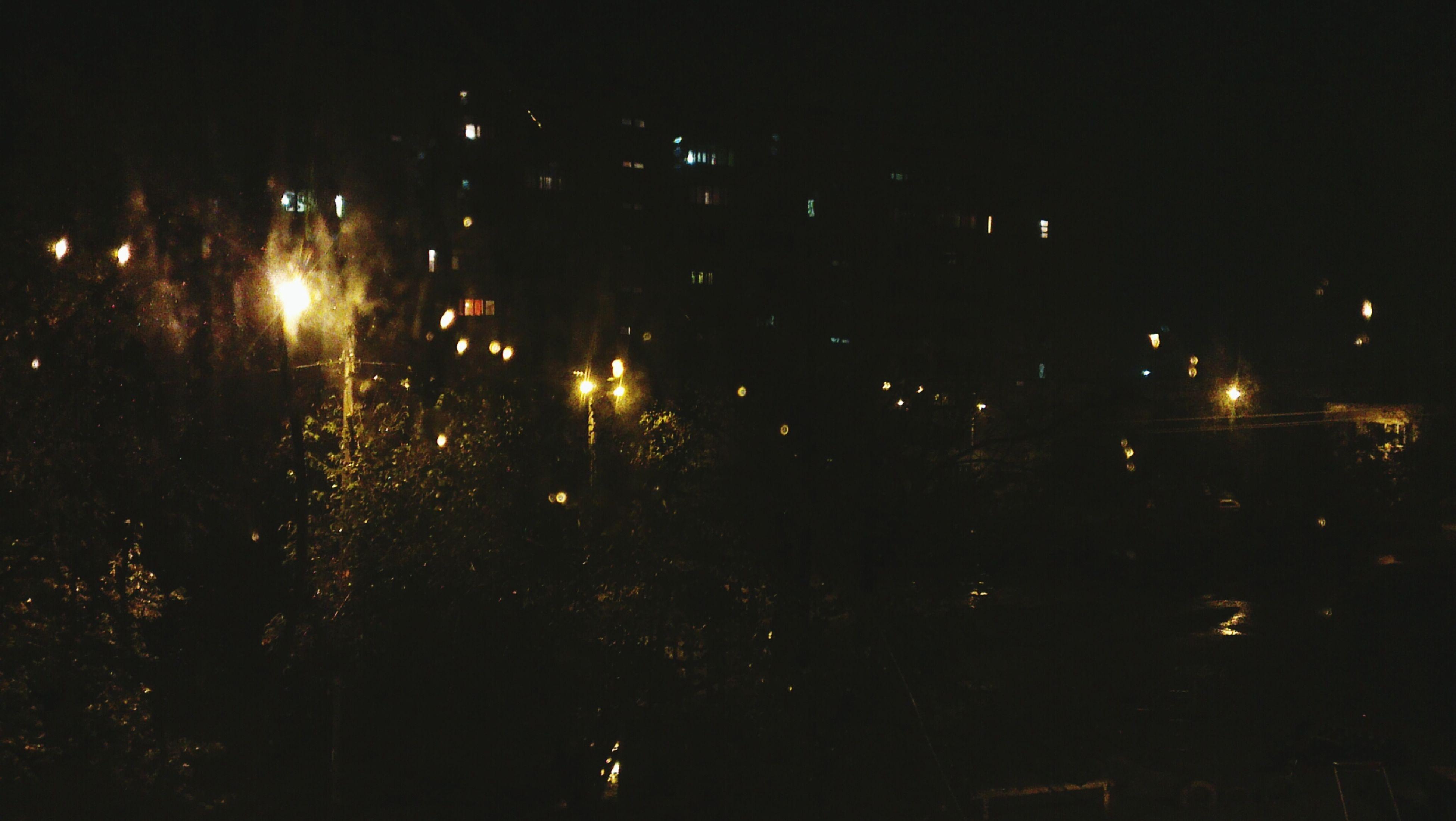 night, illuminated, lighting equipment, building exterior, street light, city, dark, built structure, architecture, light - natural phenomenon, outdoors, sky, no people, glowing, light, tree, street, residential building, residential structure, building