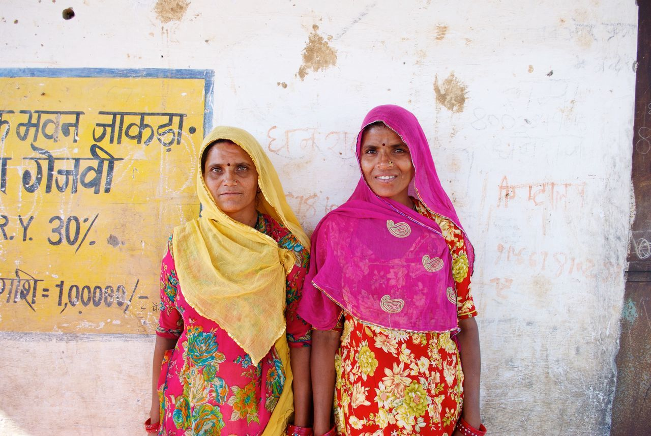 Women Around The World India Childfund Women Colors Love Two women stop their discussion about their village saving loan to allow me to take their photo. With savings, women groups are able to pool money for emergency expenses and are also able to obtain financial independence from their husbands. Empower The Portraitist - 2017 EyeEm Awards