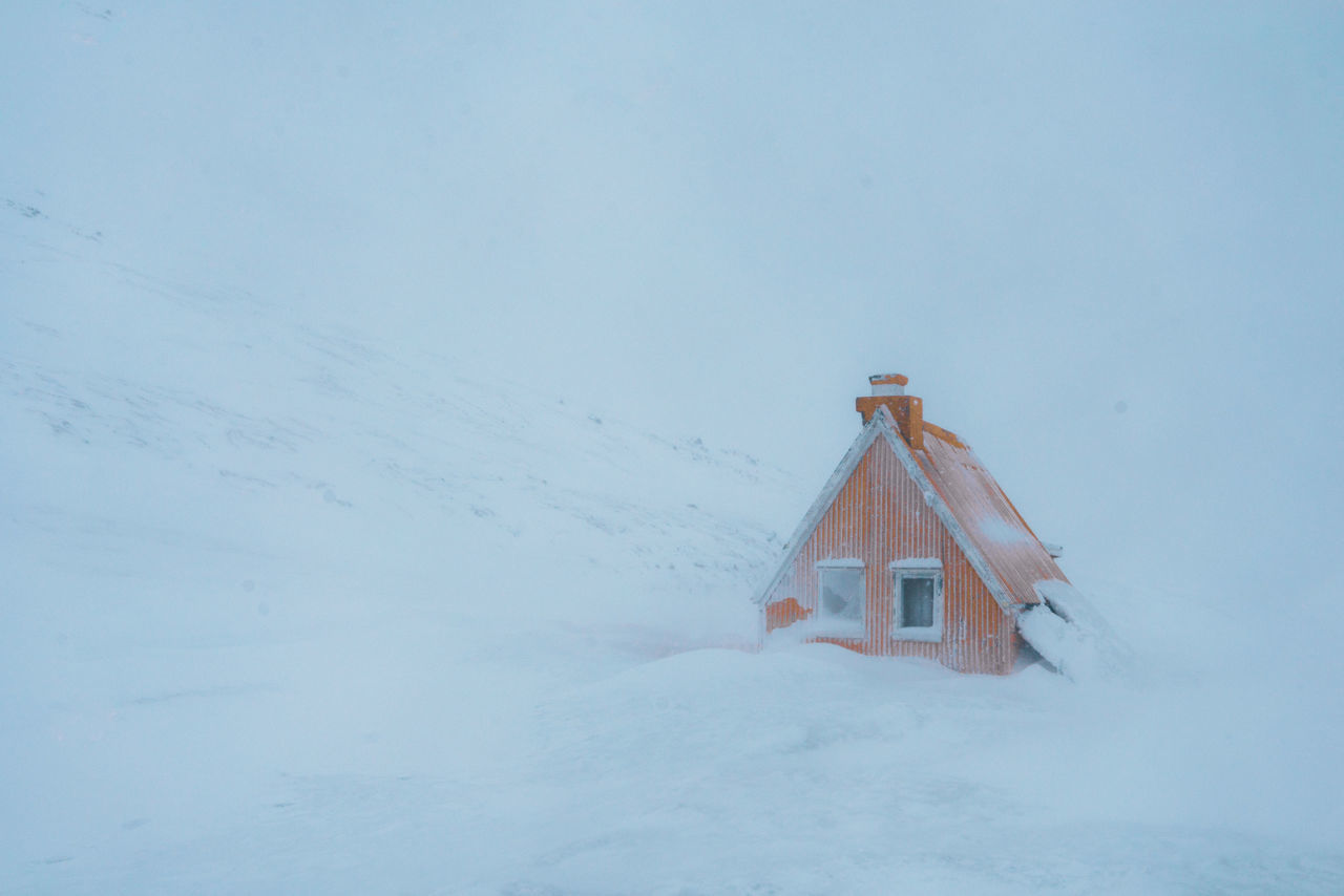Cabin in a snowstorm in Iceland Architecture Building Exterior Built Structure Cold Temperature Day House Nature No People Outdoors Sky Snow Snowdrift Snowing Weather Winter