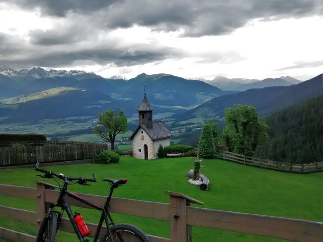 nice place ;-) After Work Architecture Beauty In Nature Built Structure City Cloud Cloud - Sky Cloudy Cubebikes Day Dome Grass Green Color Landscape Mountain Mountain Range Mountainbiketour Nature Outdoors Scenics Sky Tourism Town Travel Destinations Tree