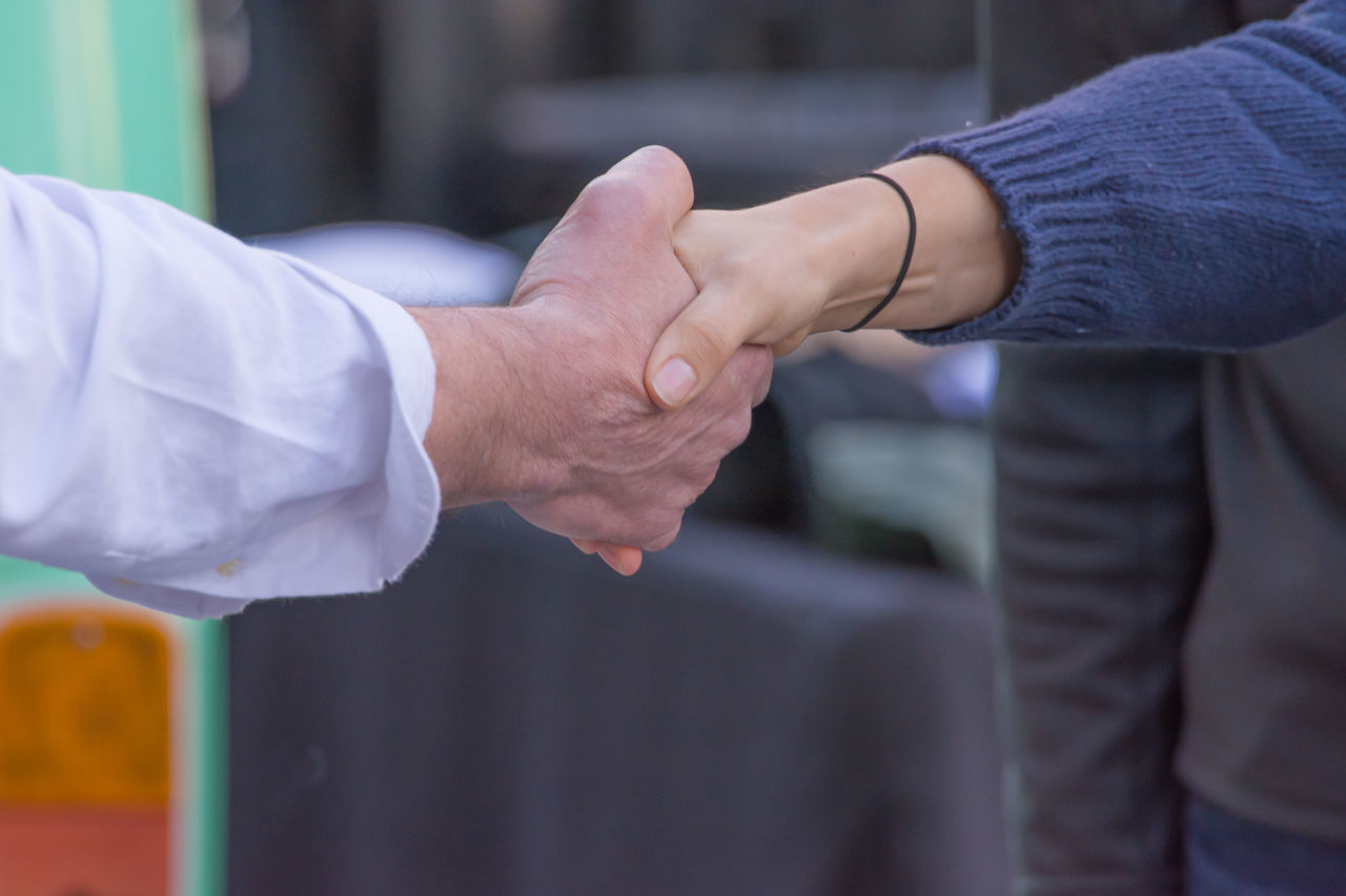 Agreement Bonding Business Businessman Close-up Cooperation Day Friendship Greeting Handshake Human Body Part Human Hand Men Occupation Outdoors Partnership - Teamwork People Real People Teamwork Togetherness Two People