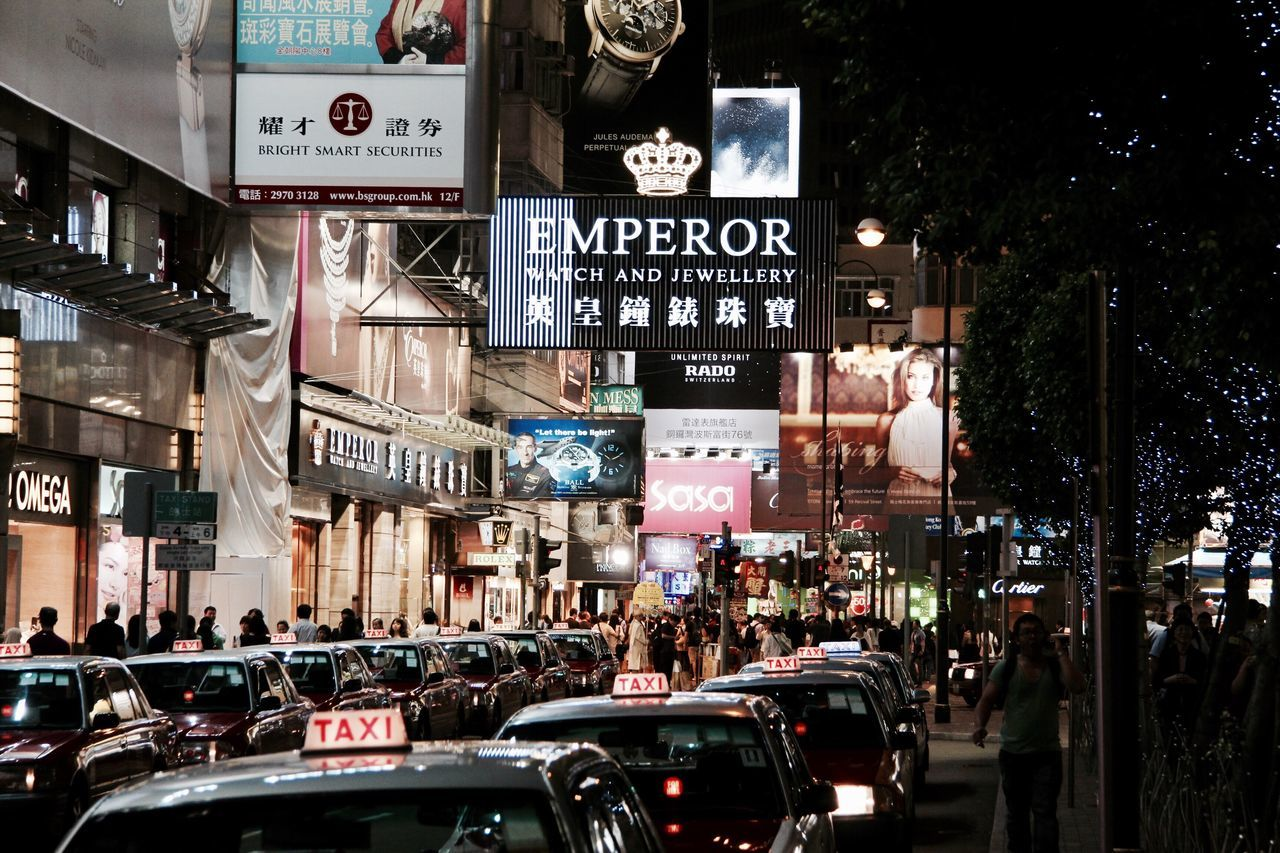 Hong Kong City Life City City Street Travel Destinations Crowd Large Group Of People People Clock Outdoors Night Taxi Taxis Lined Up Ads Luxury Dramatic Perspective Brands