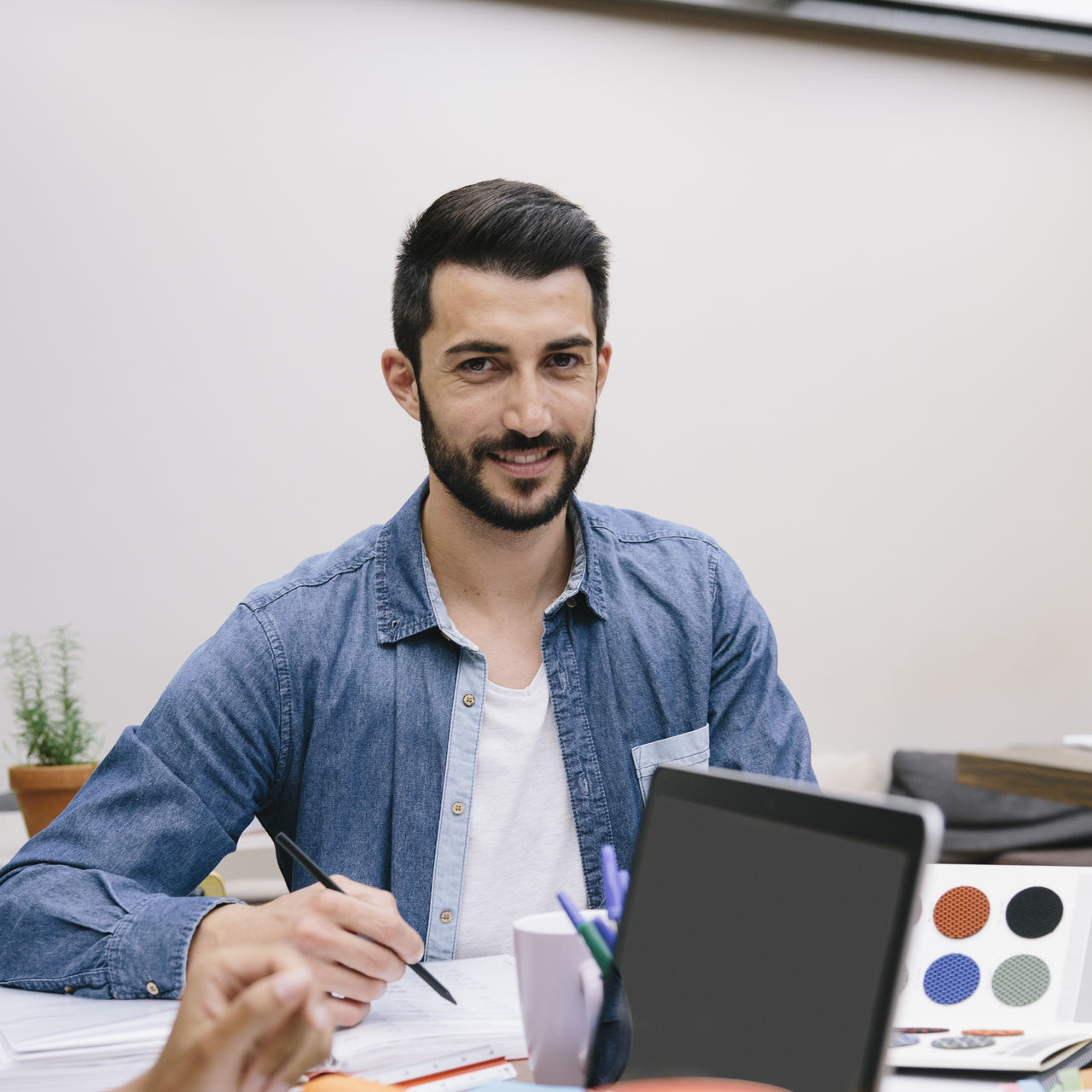 Beard Businessman Casual Clothing Color Chart Computer Coworker Design Designer  Documents Entrepreneur Ideas Laptop Office Seated Startup Work Working Young Man