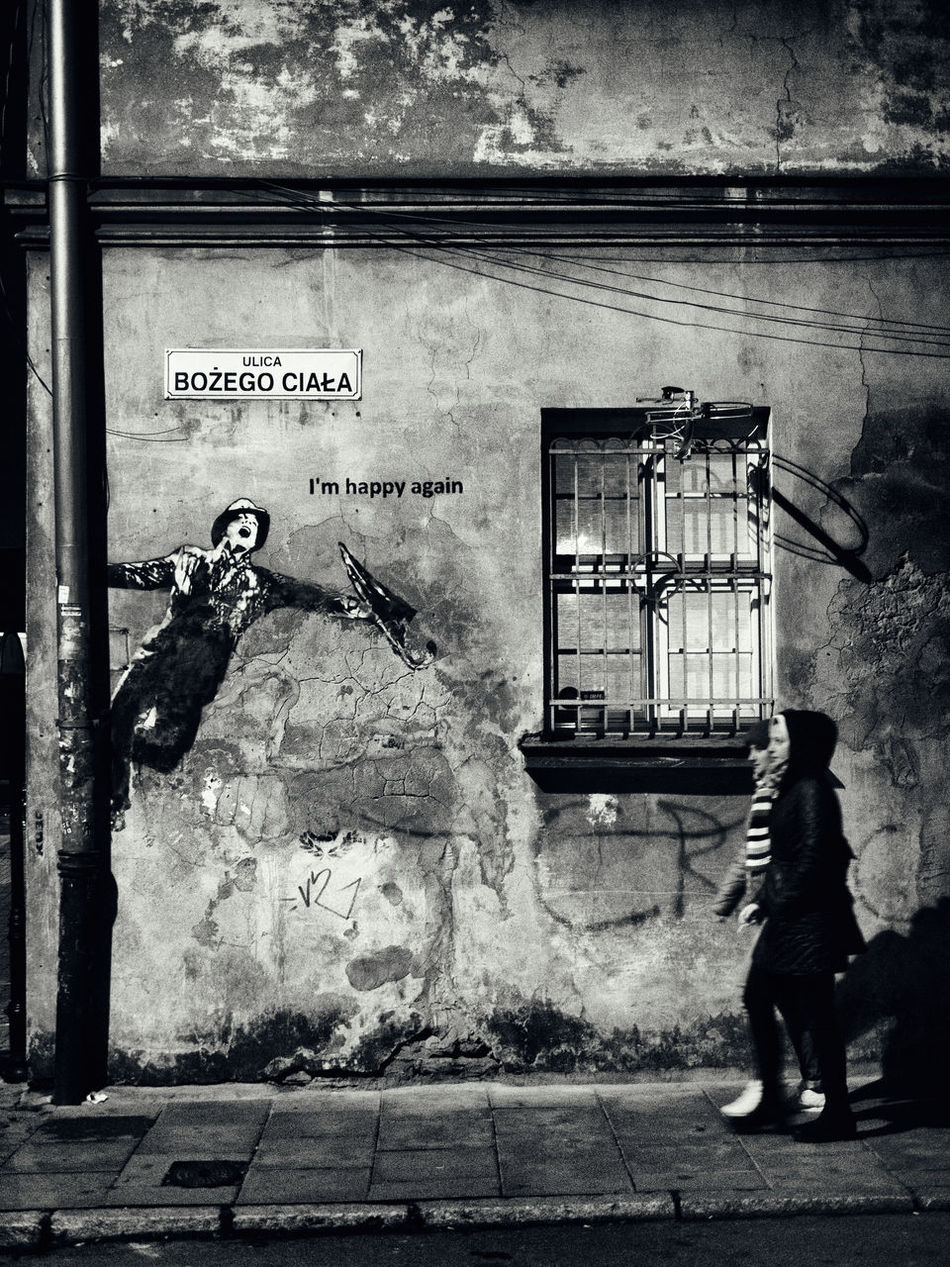 Bansky Or Not Decay Finally Going Out Graffiti Happy Happy Again I'm Happy Again Night Old Building  Singing Singing In The Rain Social Issues Ulica Window Women Writing On The Walls