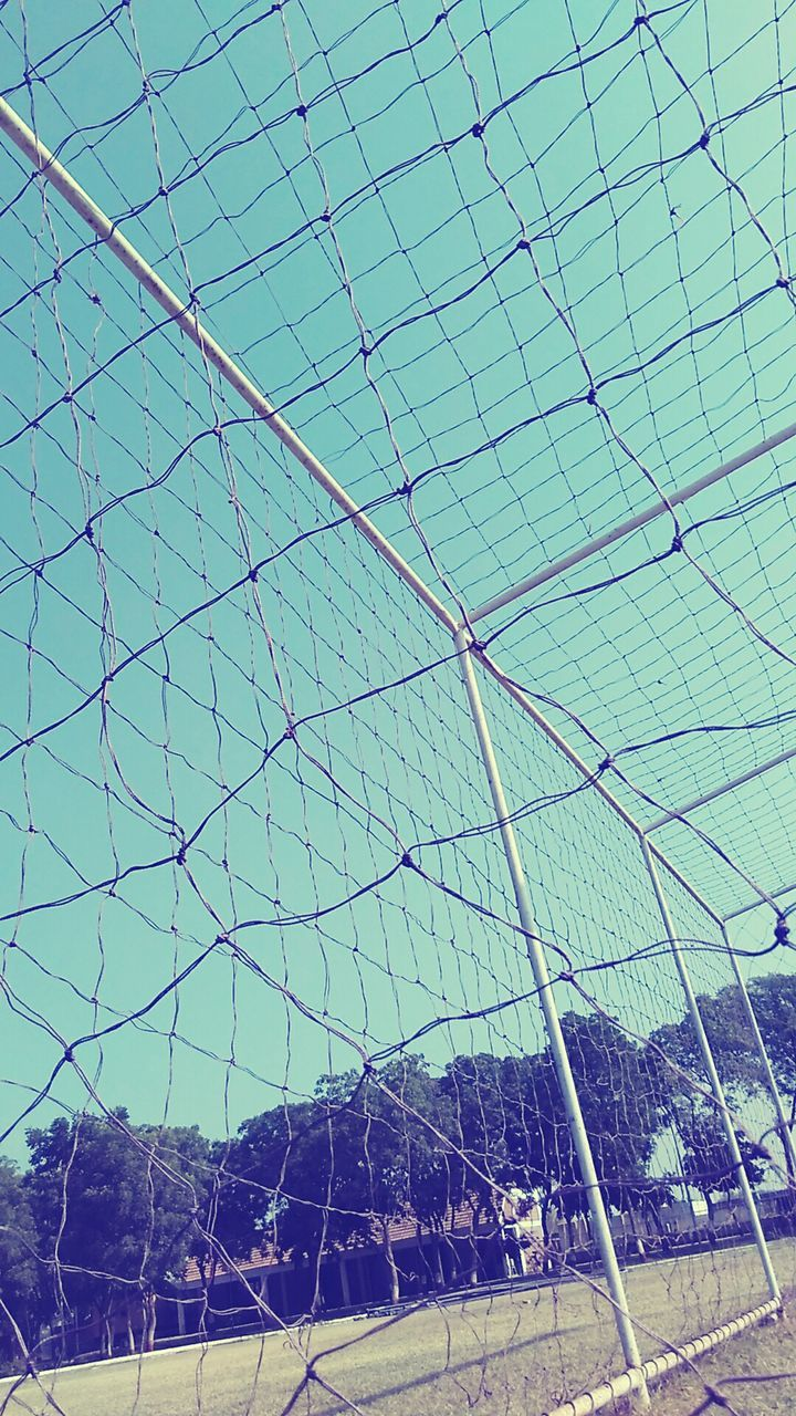 chainlink fence, day, sky, soccer, green color, no people, outdoors, low angle view, clear sky, soccer field, nature, tree, goal post