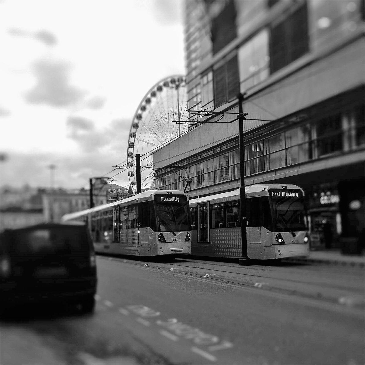 transportation, mode of transport, architecture, built structure, train - vehicle, building exterior, public transportation, land vehicle, sky, day, rail transportation, no people, city, outdoors
