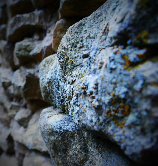 Hello light, I am dark. Nice to meet you. Abstract Close-up Dark Detail Deterioration EyeEm Focus On Foreground Full Frame Hole Macro Moss Nature No People Old Old Chimney Outdoors Part Of Rough Selective Focus Stone Stone - Object Stone Material Stones Textured  Weathered