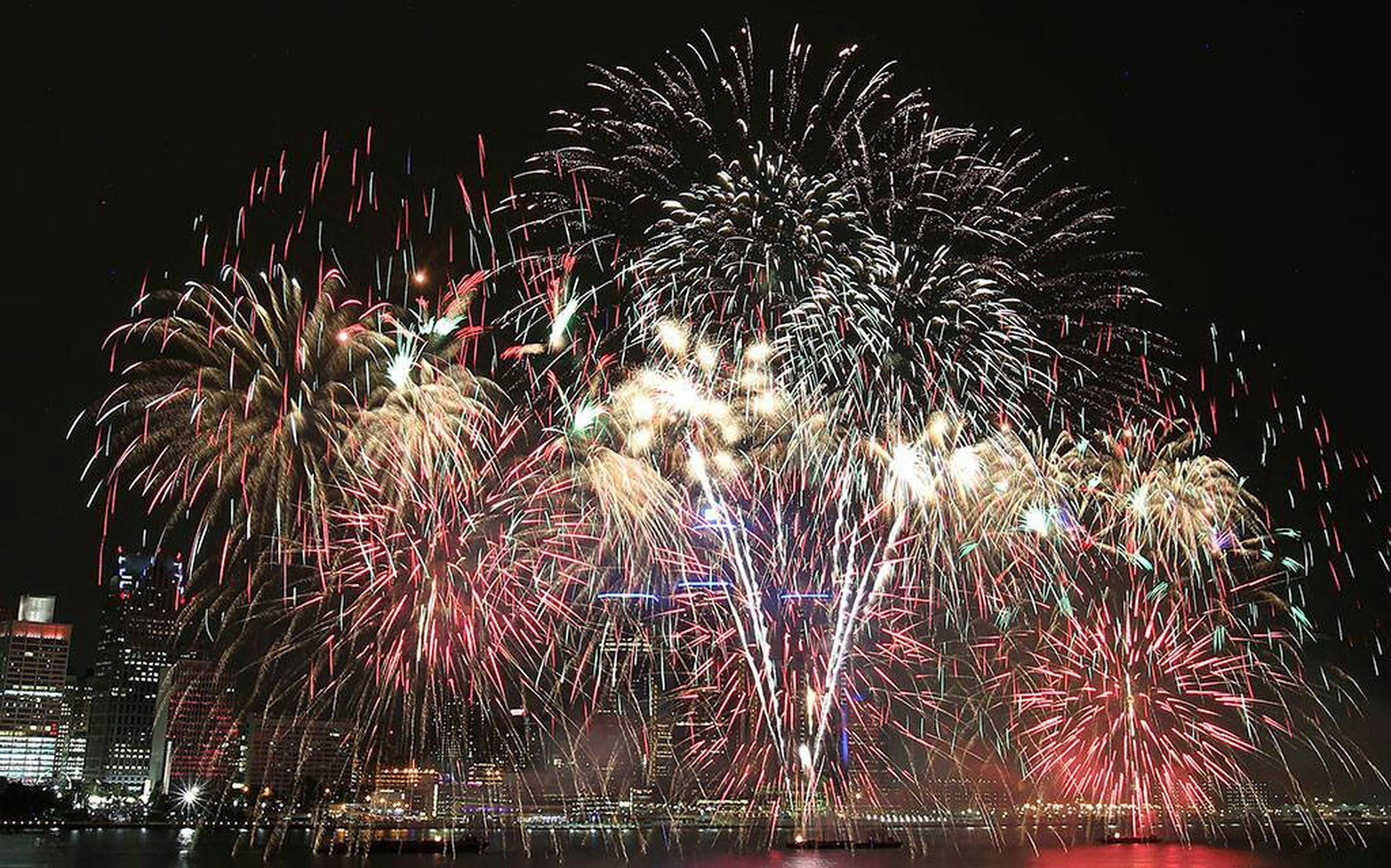 night, illuminated, firework display, celebration, exploding, long exposure, firework - man made object, motion, glowing, arts culture and entertainment, sparks, event, firework, entertainment, blurred motion, multi colored, sky, low angle view, celebration event, fire - natural phenomenon