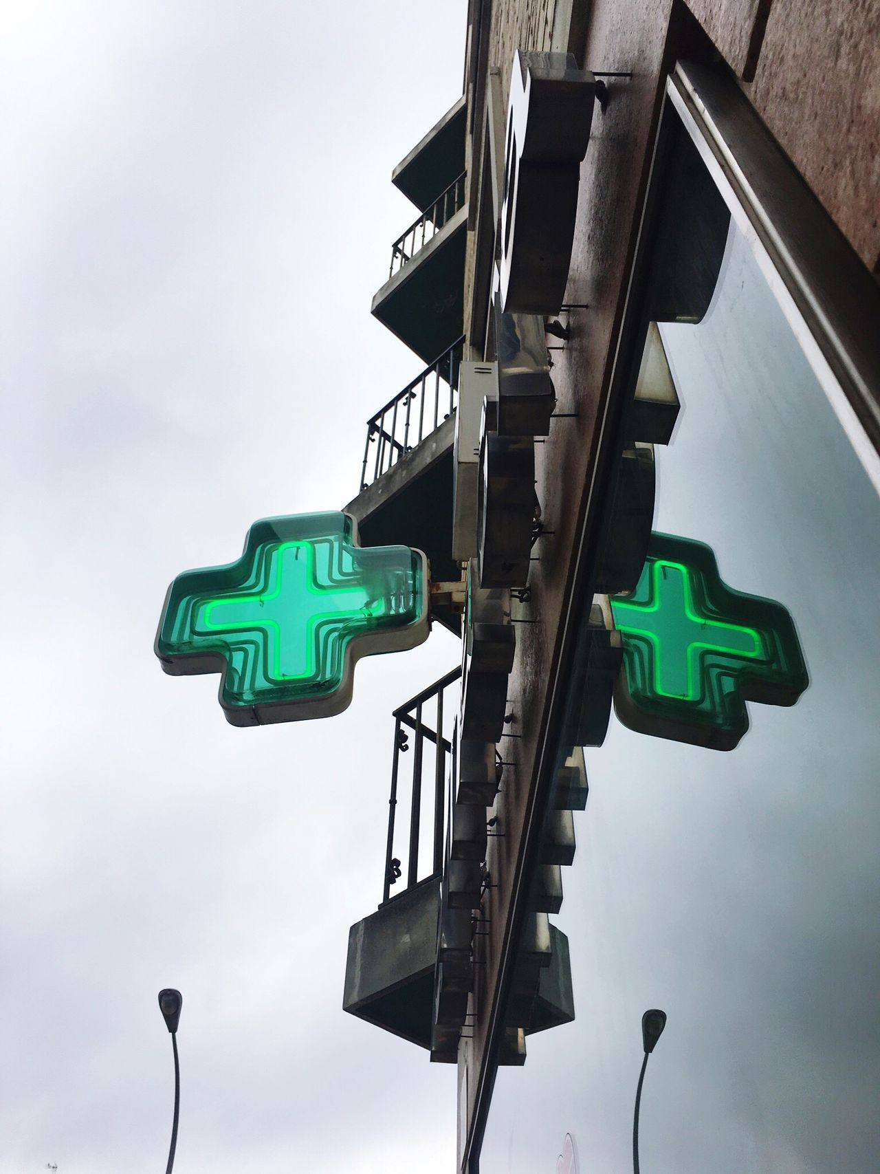 Market No People EyeEmBestPics Write Something About You Pharmacy Sky Green Color Low Angle View Cloud - Sky Outdoors Road Sign Day