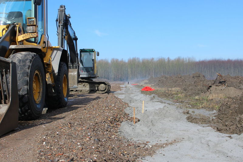 Almere Bouwplaats Clear Sky Construction Site Flevoland Graafmachine Land Vehicle Netherlands No People Oosterwold Outdoors Red Road Street Transportation