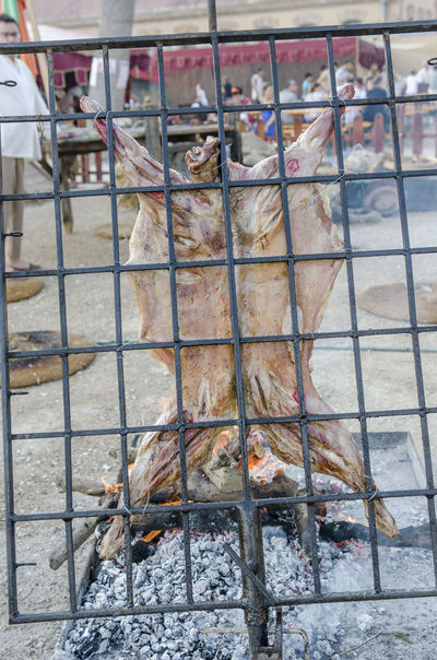 Roast lamb in renaissace, tortosa. Catalonia Grilling Holiday Lamb Meal Renaissance Tortosa Animals Barbecue Ember Grilled Meat Medieval Party