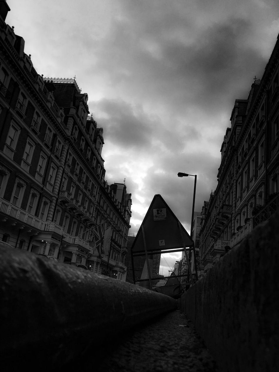 Triangles ▲ How Many Triangles Can You Spot? London From The Gutter Street Photography Men At Work  Street Works Fine Art Photography Buildings & Sky EyeEm Best Shots - Architecture Architecture Urban Exploration Black And White EyeEm Best Shots - The Streets Re Edited Vanishing Point Urban Darkness Fine Art Eyeemphotography The Week Of Eyeem Atmospheric EyeEmBestPics Clouds