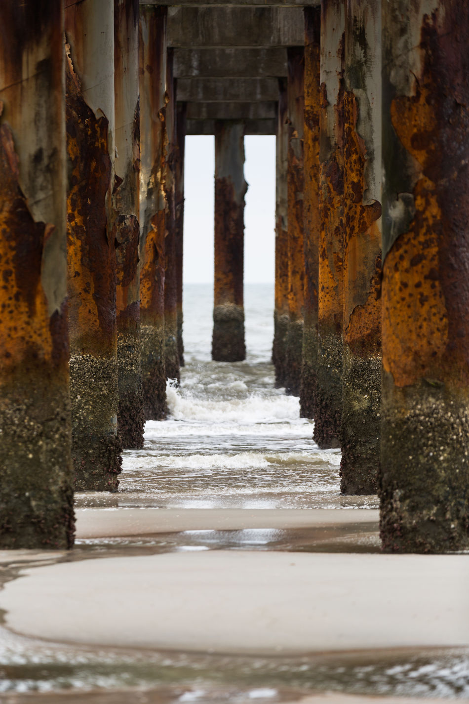 Architectural Column Architecture Bridge - Man Made Structure Built Structure Composition Day Nature No People Outdoors Pattern, Texture, Shape And Form Rusty Sand Sea Symmetrical Symmetry Textured  Underneath Water Waves