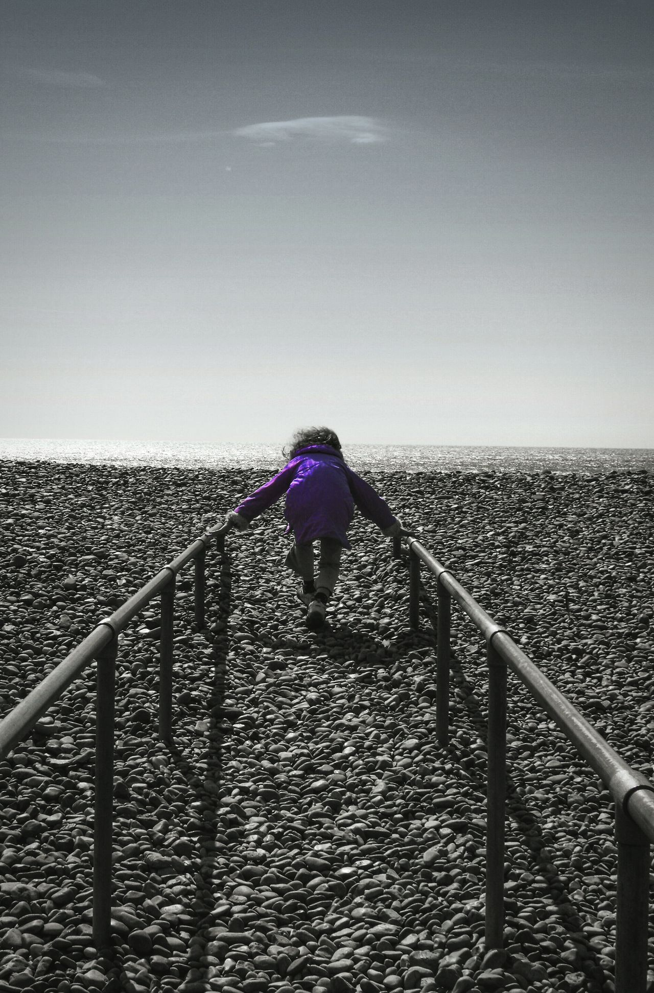 ... Who is going to stop me? ... Child Running Sea Beach Rails Cloud Pebbles Symmetry Perspective Leisure Activity Cloud - Sky One Person People Water Sky Day Nature Outdoors Horizon Over Water Full Length Purple Grey Messing Around Kid Girl