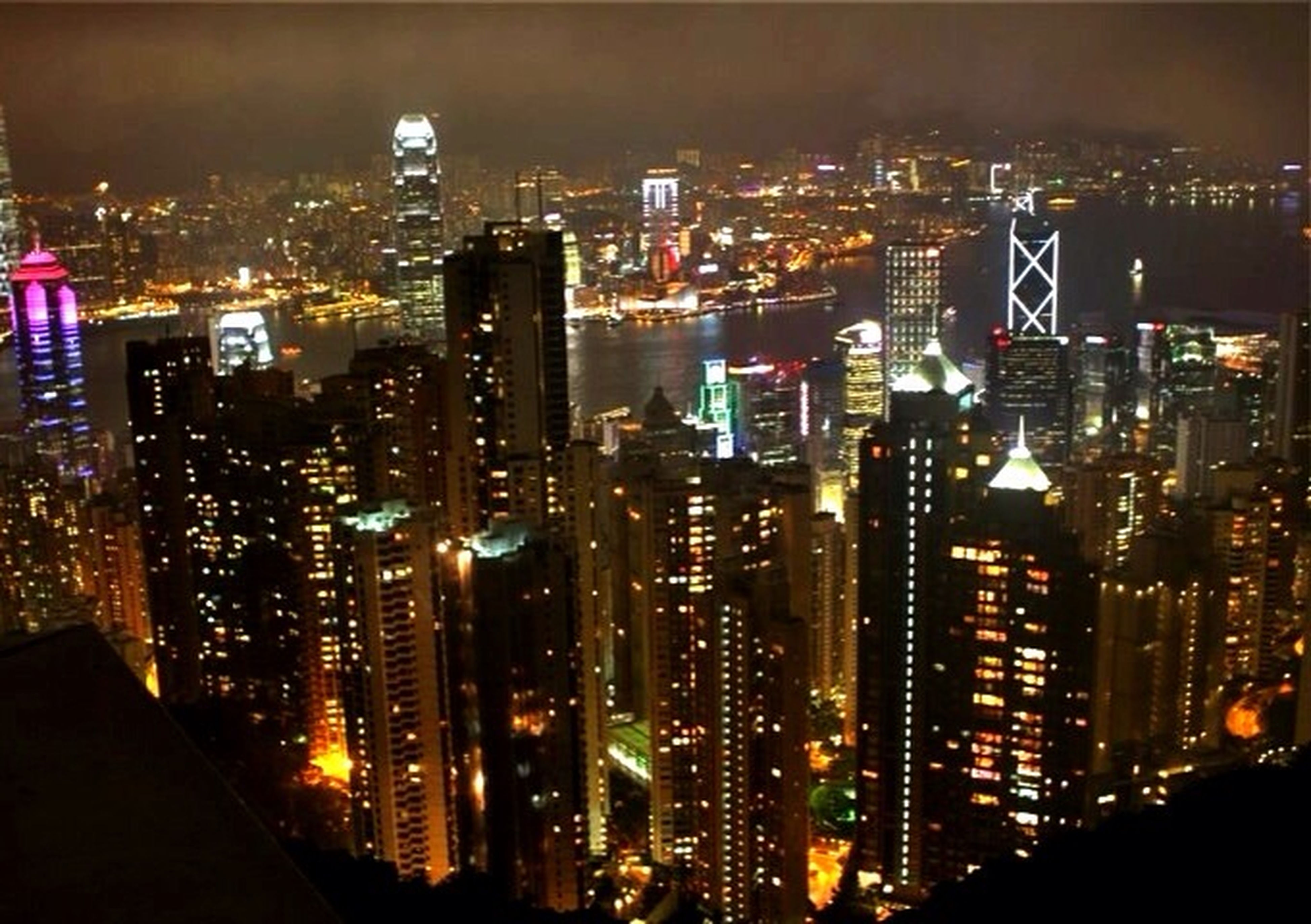 illuminated, city, night, cityscape, building exterior, architecture, skyscraper, built structure, modern, crowded, tall - high, office building, tower, financial district, urban skyline, high angle view, city life, capital cities, residential building, downtown district
