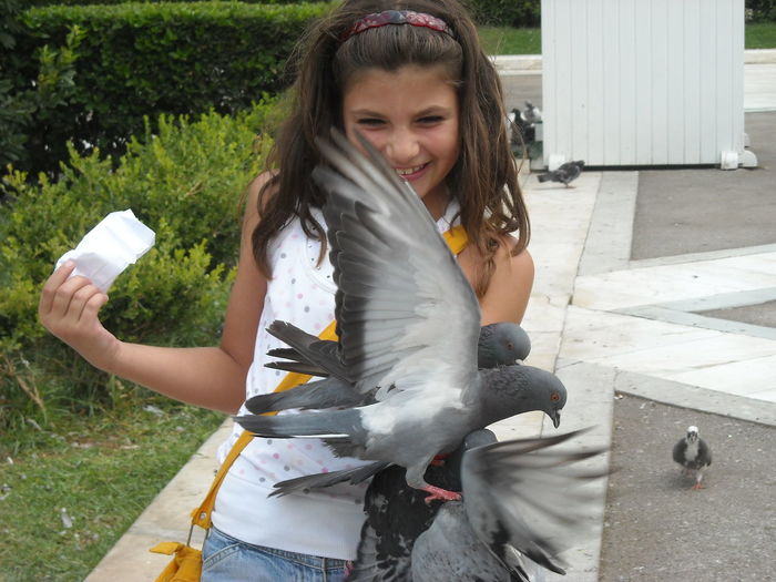 Summer Holidays Happy Girl Feeding Pigeons Sindagma Athens, Greece