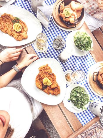 Plate Food Food And Drink Human Hand Meat High Angle View Table Indoors  Ready-to-eat Real People Human Body Part Meal Healthy Eating Day Freshness One Person People Schnitzel Austria