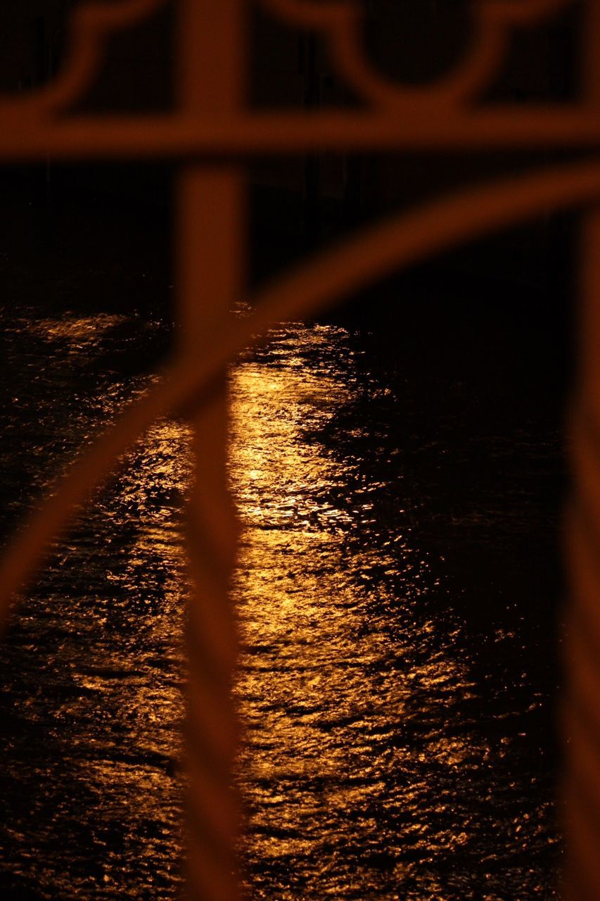 Reflection In River Seen From Gate