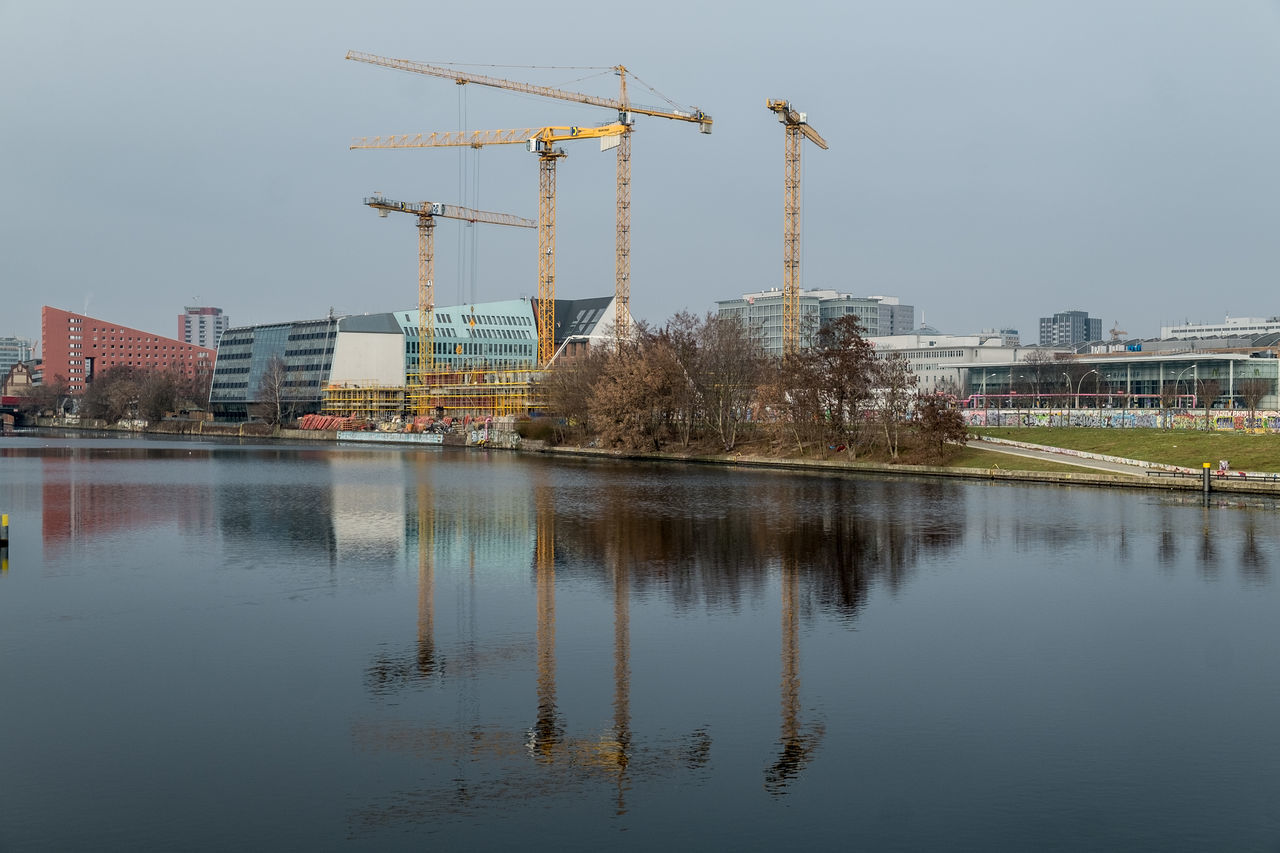 Architecture Berlin Building Exterior Built Structure Construction Construction Machinery Crane Crane - Construction Machinery Day Development No People Outdoors Reflection Sky Spree Spree River Urban Skyline Water