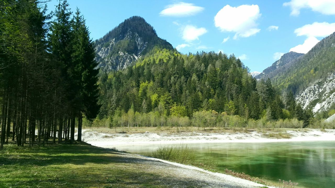 Lake Jasna, Kranjska Gora, Slovenia Lakejasna Slovenia Water Lake Idyllic Sky Mountain Range Forest Lake And Mountain Nature Solitude Green Color Non-urban Scene Beauty In Nature Tranquil Scene