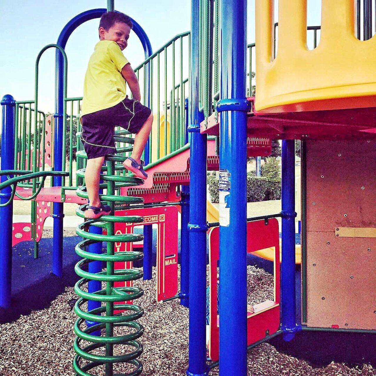 Full Length One Person Playground Casual Clothing Lifestyles Childhood Jungle Gym Outdoors Real People Day Young Adult People Playing Happy Playtime Climbing