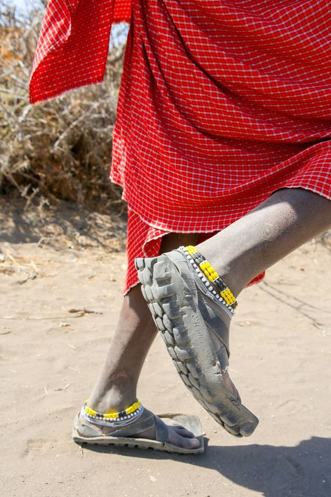 Shoes Masai Masai Village Upcycled Low Section Person Human Foot Lifestyles Walking Standing Shoe Person Human Limb Footwear Casual Clothing Canvas Shoe Footpath Outdoors Fashionable Day Style