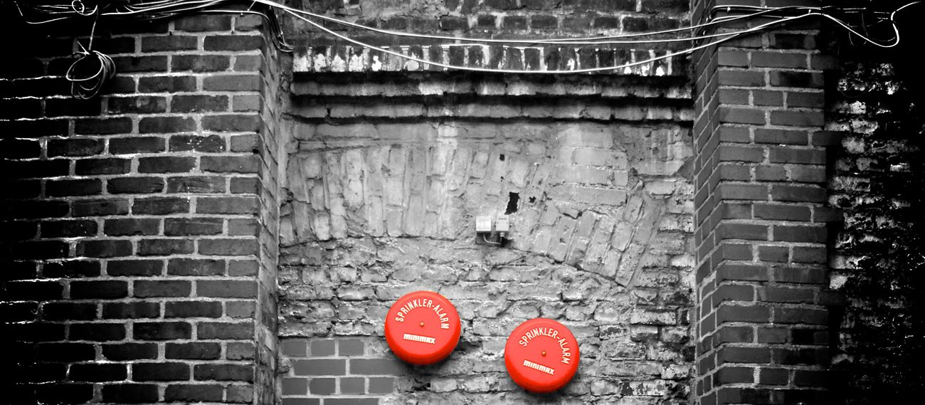Brick wall with fire alert bells. Architecture Brick Wall Built Structure Cologne Day Feueralarm Fire Alarm Fire Alert Helios Area Köln No People Outdoors Red Wall
