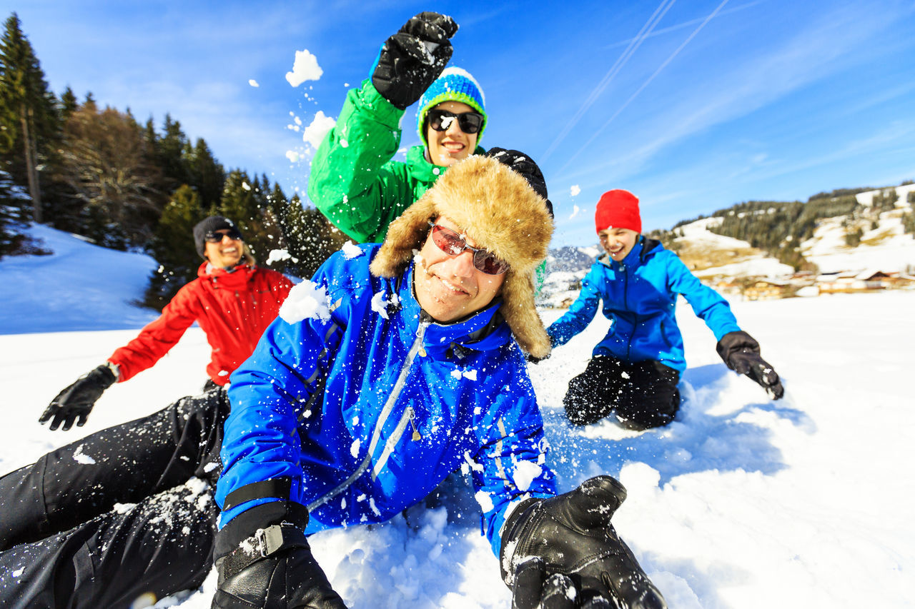 Winter fun Action Austria Family Fighting Four People Fun Group Of People Group Shot Happy Healthy Lifestyle Holidays Lying Down Mountains Nature Outdoors People Sky Snow Snowball Together Togetherness Winter