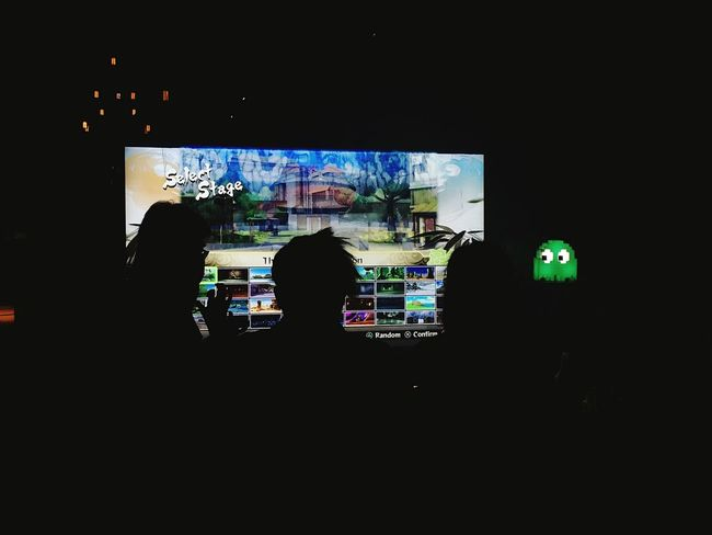 Illuminated Silhouette My Favorite Place Dark Night Game Group Of People Person Indoors  Pacman Gaming People And Places The Color Of Technology