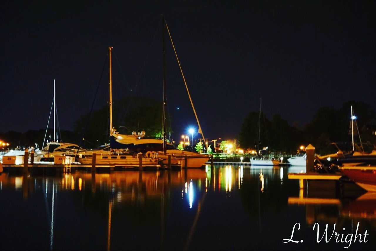 night, water, illuminated, reflection, nautical vessel, moored, sailboat, marina, yacht, mast, outdoors, sky, sea, transportation, no people, harbor, built structure, architecture, nature, sailing ship
