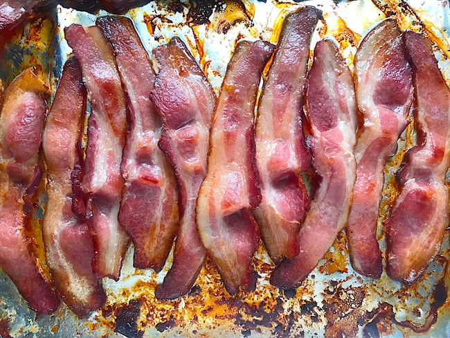Oven-cooked bacon Bacon Close-up Cooking Day Delicious Fatty Meat Foil  Food Preparation Grease Home Cooking Indoors  Natural Light No People Oil Overhead Phone Camera Pork Roasting Savory Food Several Strips Of Bacon Textures