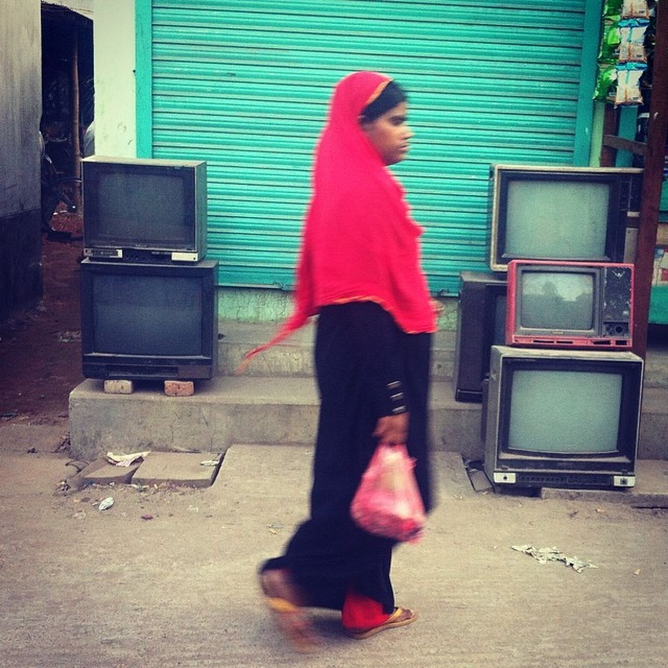 a daily life in chaktai street. Js Street Woman Tv Television Color Red Green Daily Life Photography Photojournalism Documentary Instagram Chaktai Chittagong