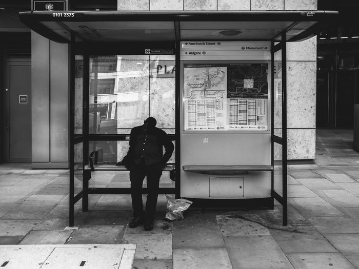 Bus Stop. Rawstreets Maxgor Streetlife People One Person Strangers In The City Cıty Life Urbanlife Real People Maxgor.com 35mm Cıty The Week On EyeEm Stranger Monocrome Black And White Bus Stop City Of London Sdcofilm