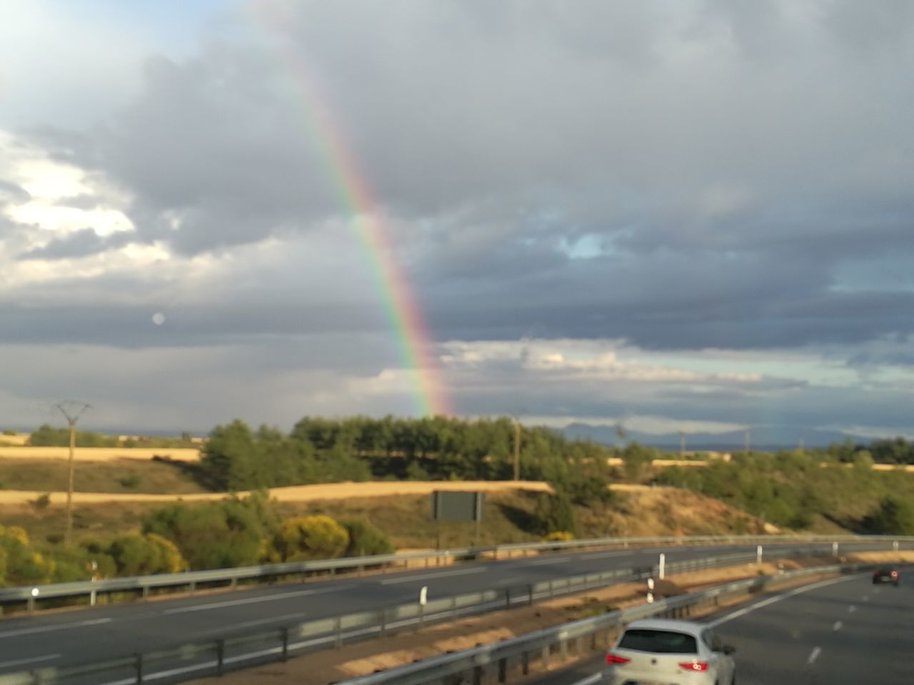 rainbow, transportation, road, cloud - sky, sky, double rainbow, car, mode of transport, no people, scenics, speed, nature, outdoors, motion, day, beauty in nature, tree