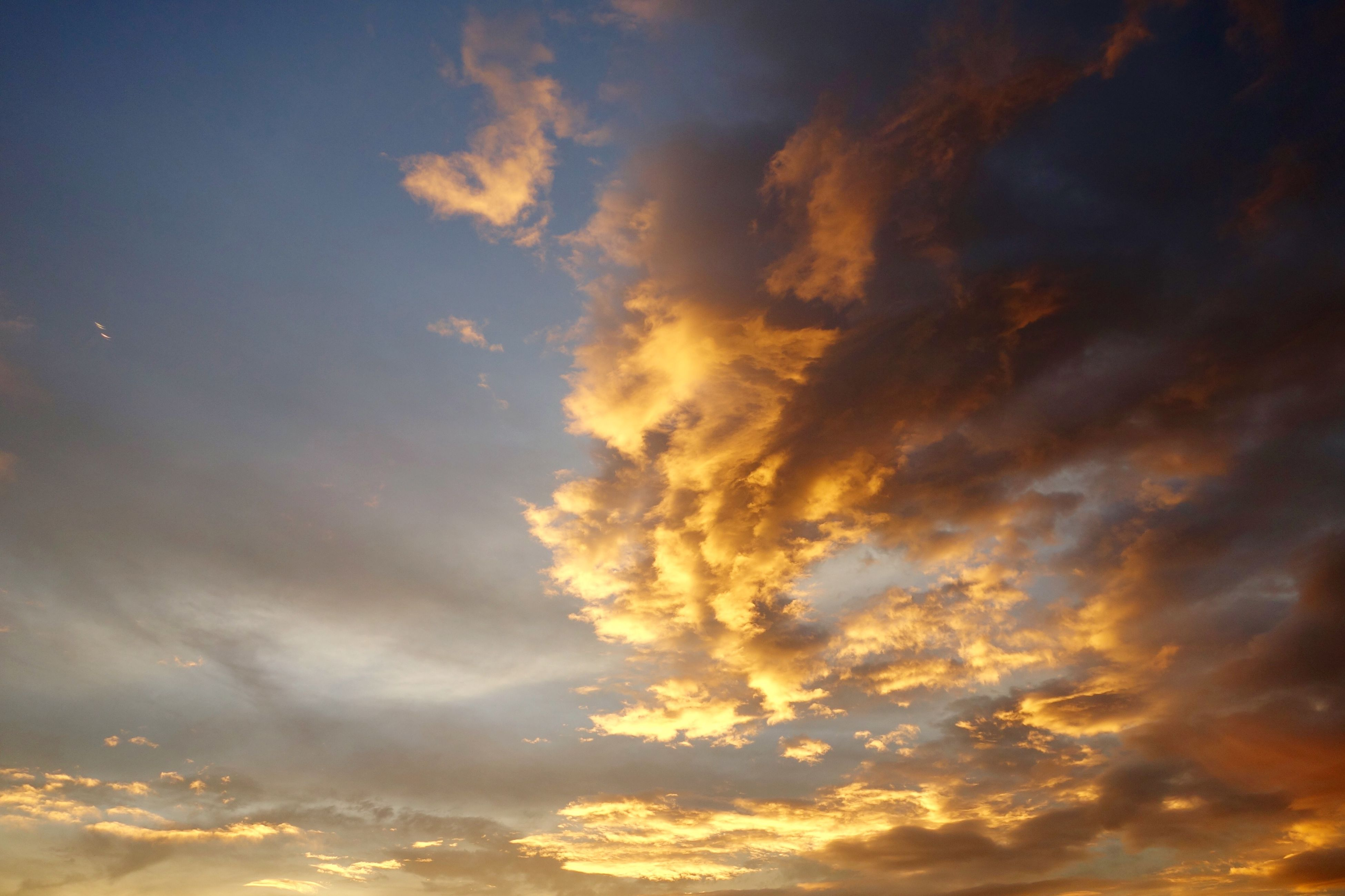 sky, sunset, cloud - sky, beauty in nature, scenics, tranquility, low angle view, tranquil scene, cloudy, sky only, cloudscape, nature, orange color, dramatic sky, idyllic, cloud, backgrounds, majestic, weather, silhouette