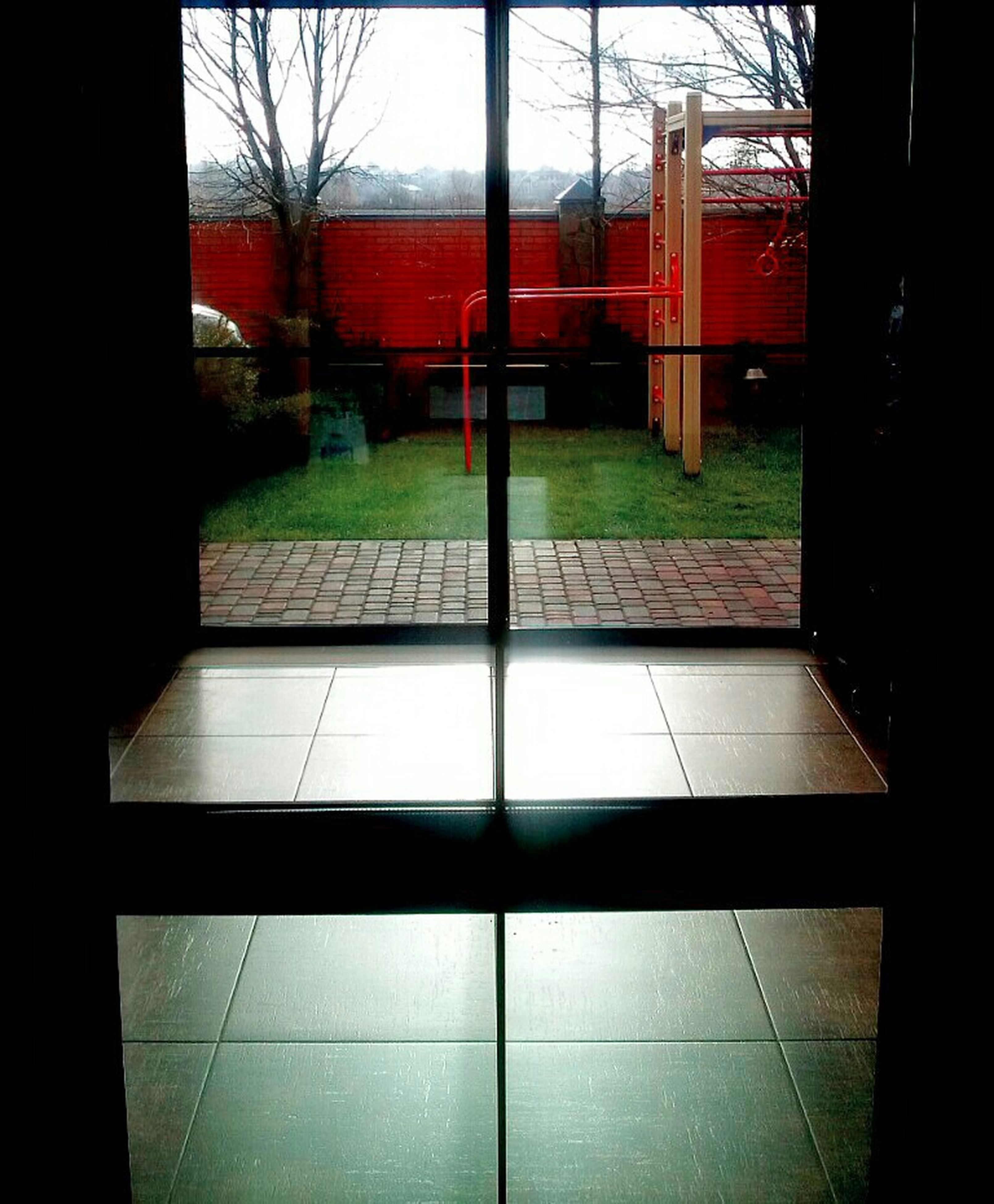 indoors, transfer print, window, architecture, built structure, tiled floor, glass - material, transparent, auto post production filter, flooring, building exterior, absence, reflection, empty, door, shadow, sunlight, tile, glass, day