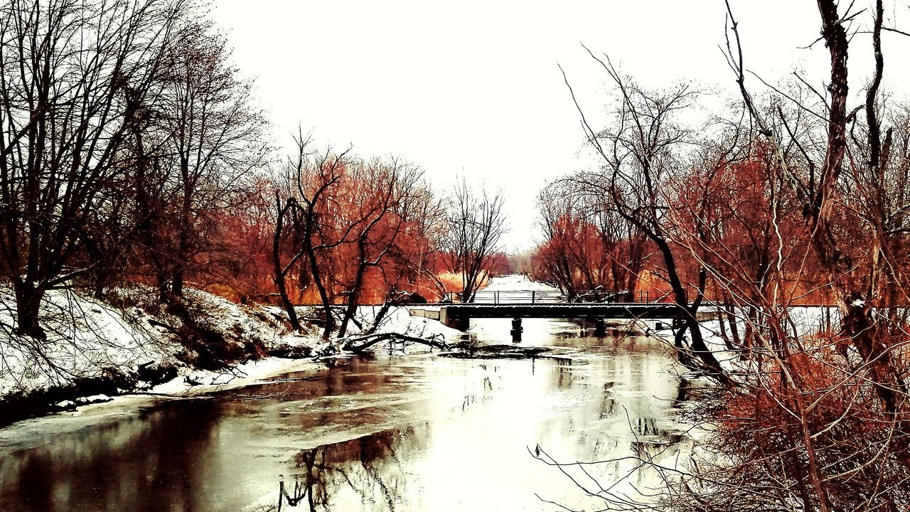 Forest ablazed... Fire And Ice Photography Snow Covered Water Sky Nature Tree Outdoors Reflection Landscape Tranquil Scene Non-urban Scene Train Bridge Train Tressel Rivers And Streams Orange Background Landscapelovers Ladyphotographerofthemonth