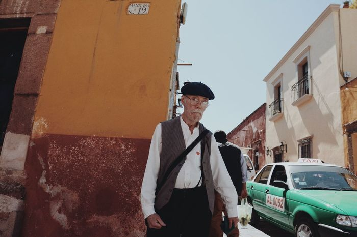 Exploring Mexico One Person Outdoors Car Front View Standing Street Real People City Transportation Lifestyles Day Well-dressed People Streetphotography The Street Photographer - 2017 EyeEm Awards Live For The Story BYOPaper!