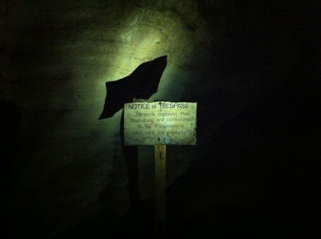 Board Cave Communication Geometric Shape Glow Worm Cave Gold Mine Hoehle Illuminated Information Sign No People No Trespassing Outline Pole Signboard Symbol Tropfsteinhöhle Wall - Building Feature Wild West