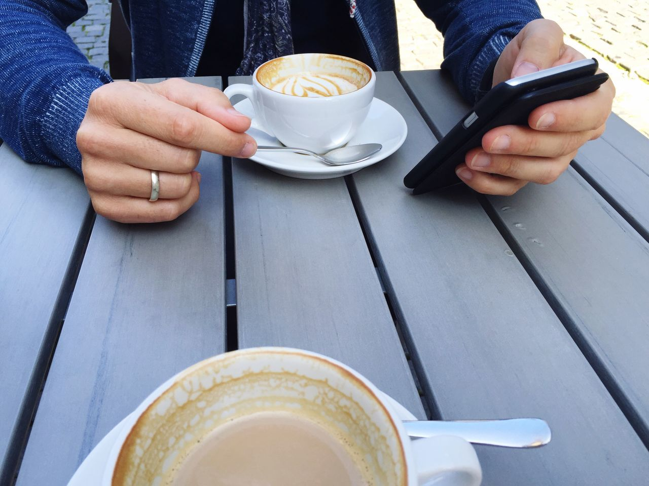 Mobile Conversations Coffee - Drink Coffee Cup Holding Men Table Real People One Person Human Hand Adult Phone Working Work Misshappiness
