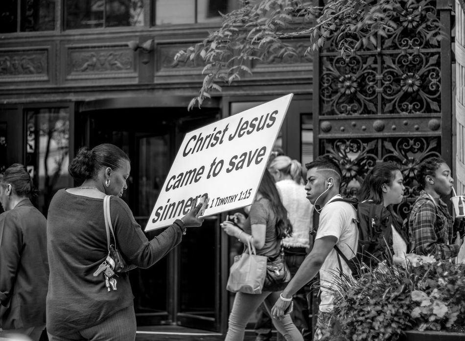 making her statement 215 Philly Architecture Built Structure Casual Clothing City City Life Day Focus On Foreground Information Sign Leisure Activity Lifestyles Making A Statement  Men Opinion Outdoors Philly Phillystreetphotography Protesting The Street Photographer - 2016 EyeEm Awards
