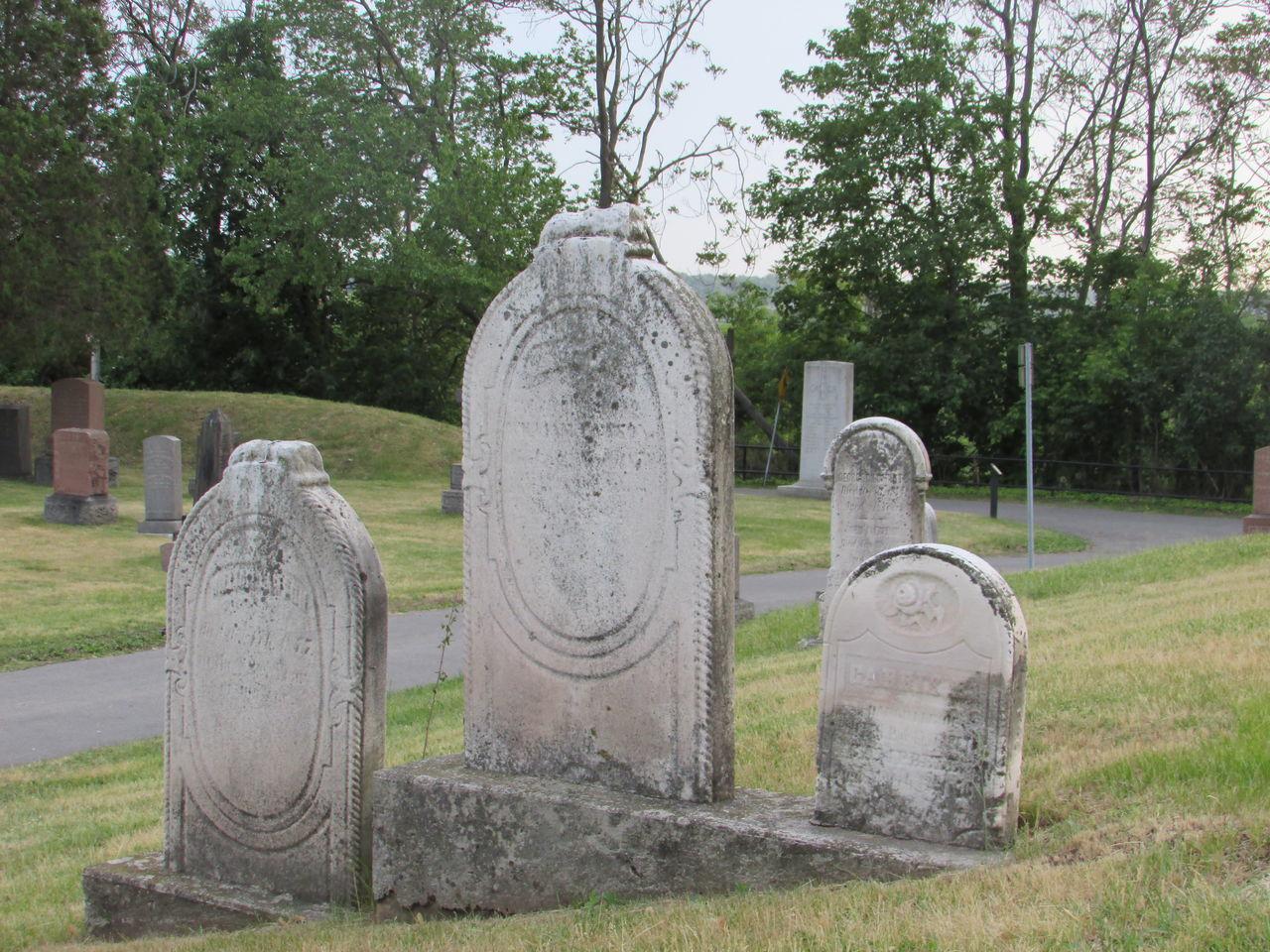 tombstone, cemetery, memorial, tree, graveyard, gravestone, day, grave, no people, outdoors, spirituality, grass, sky