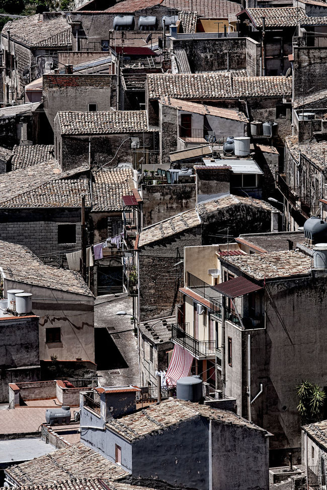 View over the rooftops 4 Architecture Architecture Brown Color Building Exterior Built Structure City City Life Day Exterior Houses No People Outdoors Residential Building Residential District Residential Structure Roof Pans Rooftops Stone Wall Town