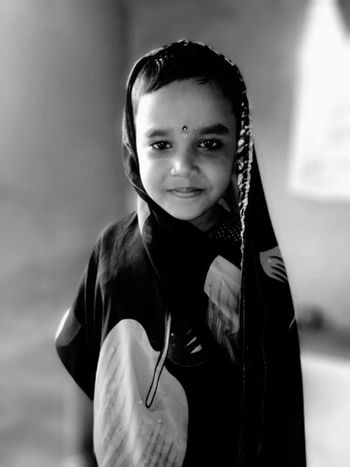 Looking At Camera Portrait Children Only Child One Person Childhood Smiling Cape  People Front View One Girl Only Confidence  Standing Holding Hooded Shirt Happiness Indoors  Day Adult