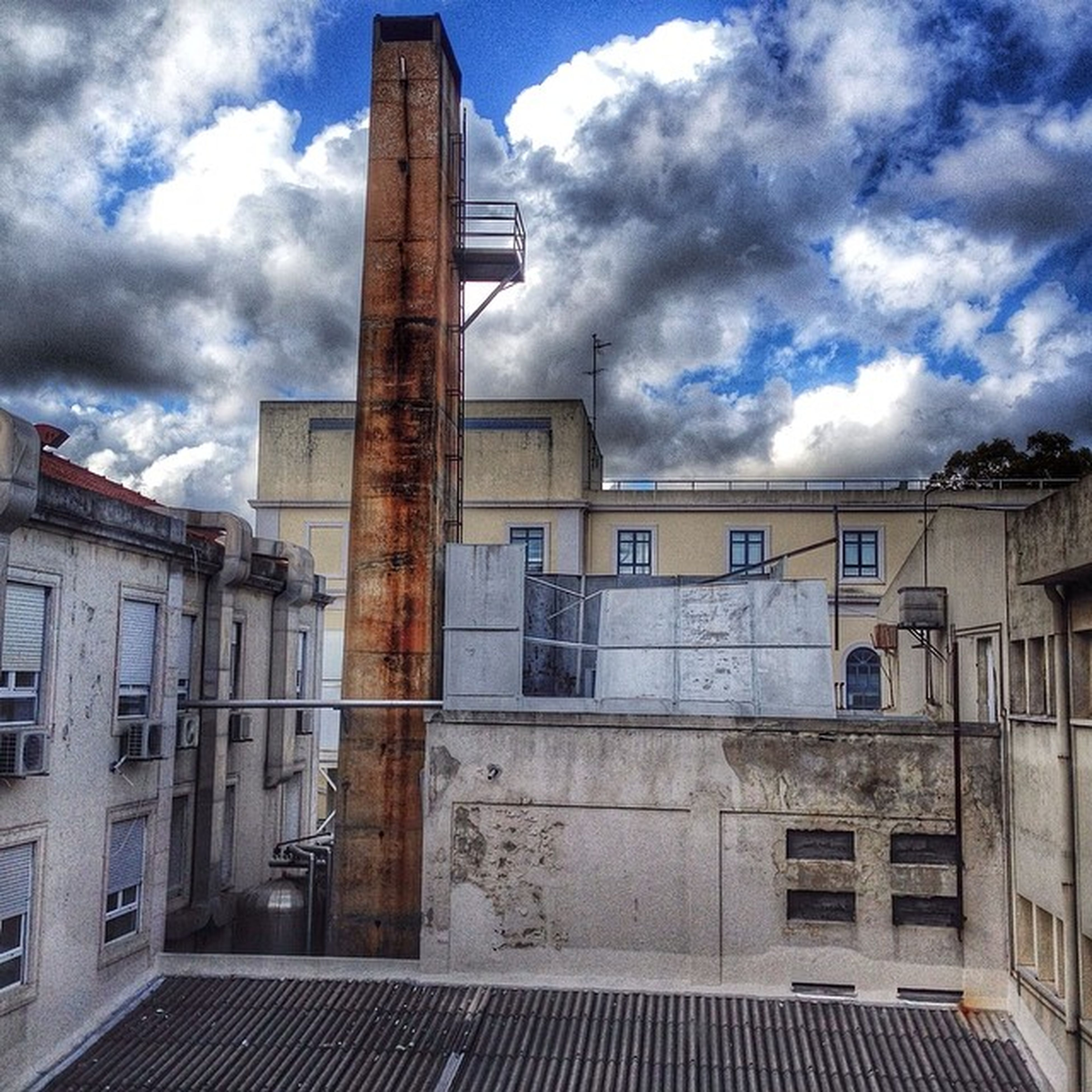 architecture, built structure, building exterior, sky, cloud - sky, cloudy, window, cloud, building, low angle view, exterior, residential building, residential structure, facade, day, old, city, outdoors, no people, house