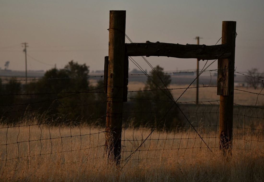 Barbed Wire Wooden Post No People Night Outdoors Sky Fireskysunset Smoked Out Countryside Glamour EyeEm Best Shots EyeEm Gallery Eyeemphotography Sunlight Countryside Views Duskview