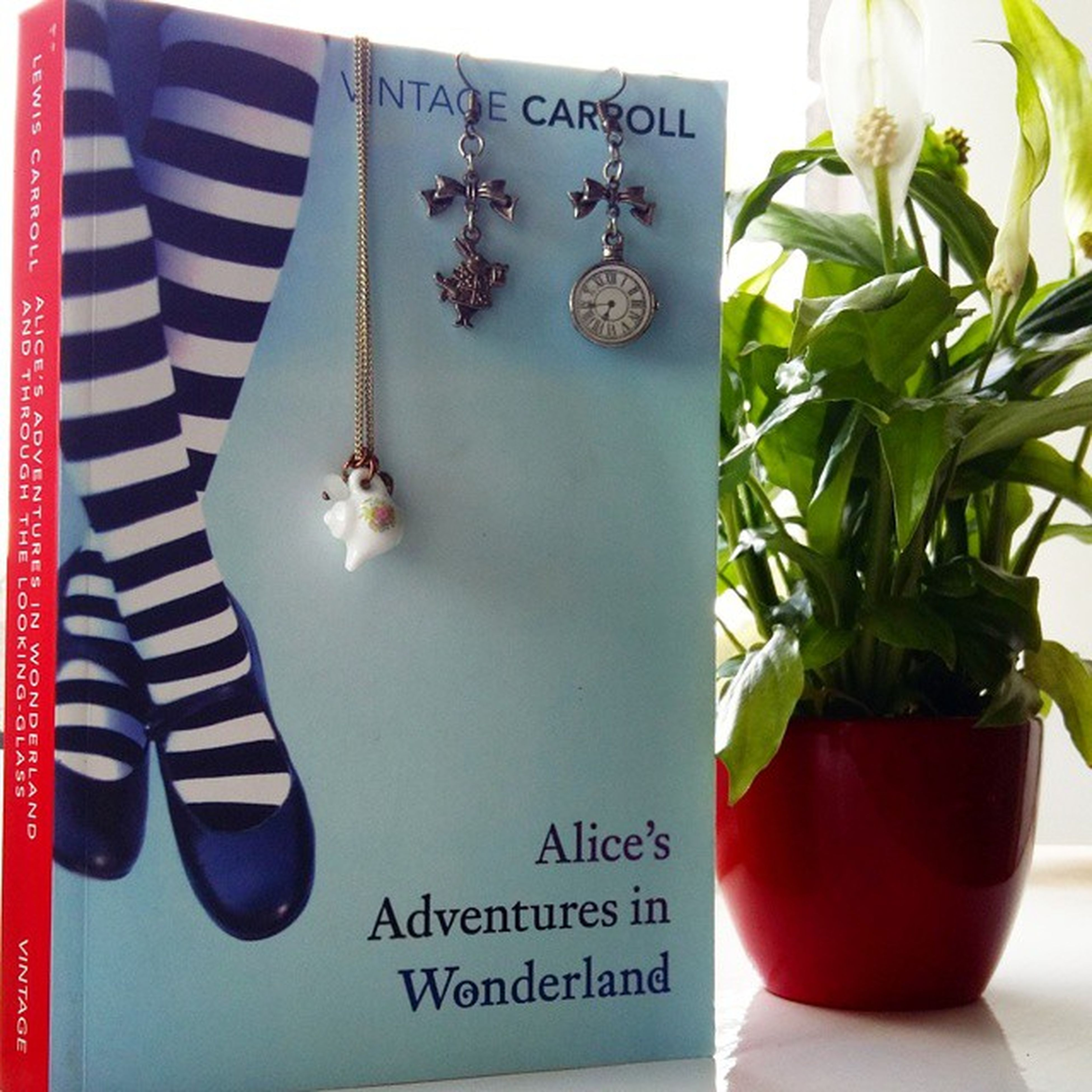 I was tagged in Bookandjewelry by @read.ing.books and @thomasthespook so here is my Alice In Wonderland earrings from @twopennylane and a cute tea cup necklace from Accessories Aliceinwonderland LewisCarroll Childrensbooks Reading Jewelry Twopennylane Twopennylanejewellery Accessories TeaCup Whiterabbit Books Bookstagram Bibliophile  Book British Bookphotography Bookblog Bookporn Booknerd